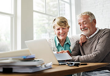 Image of older couple reviewing insurance information